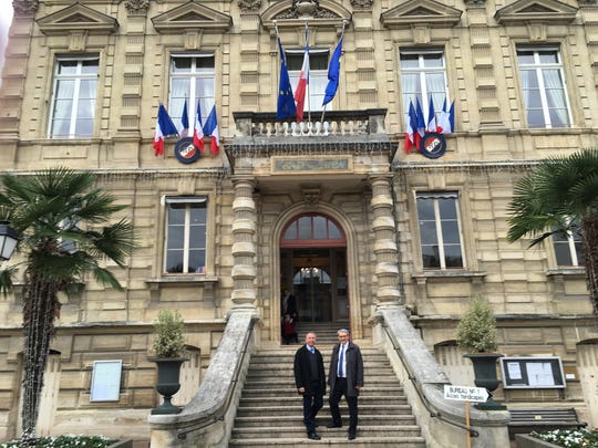 St. Cloud Mayor Dave Kleis, left, stands with Dominique Lebrun, first deputy mayor of Saint-Cloud, France, in front of the city hall in Saint-Cloud.