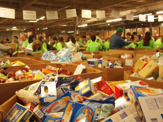 Forty-five team members from QuickChek's corporate headquarters in Whitehouse Station and individual stores volunteered to help sort food at the Community FoodBank of New Jersey in Hillside on Dec. 17, aiding thousands of area families and individuals in need during the holiday season.