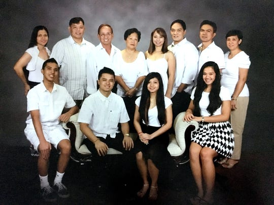"Adonis Flores' family photo. Front row, from left to right are: Arvin Flores (grandson), Argie Flores (grandson), Arlie Bonto (granddaughter), Alina Bonto (granddaughter). Back row, from left to right are: Ma. Gracita Flores (daughter in law), Arvil Flores (son), Adonis ""Don"" Flores, Dolores Flores (wife), April Flores (daughter), Reggie Obispo, Aaron Bonto (son in law), Alice Bonto (daughter)."