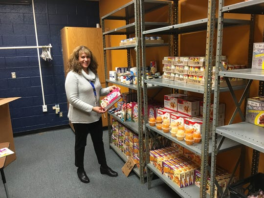 Ruidoso High School social worker Luisa Rodriguez displays the fresh inventory of snack foods and cereals she now has in hand for hungry students who don't get enough to eat at home.