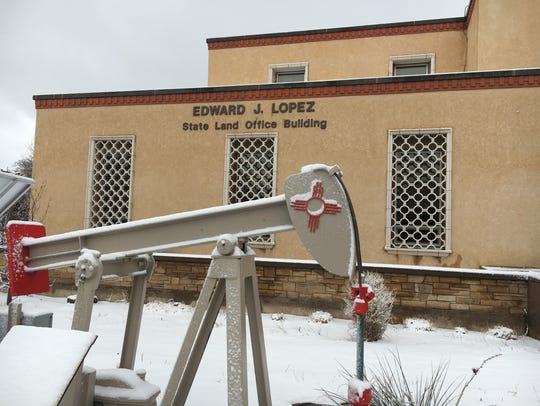 Land Commissioner Aubrey Dunn replaced a brick sculpture in front of the State Land Office with this oil pump jack in 2015. Candidate Garrett VanKlasen says any monument at the office should depict a child holding a book, as a reminder that that permanent fund is intended to support public education.