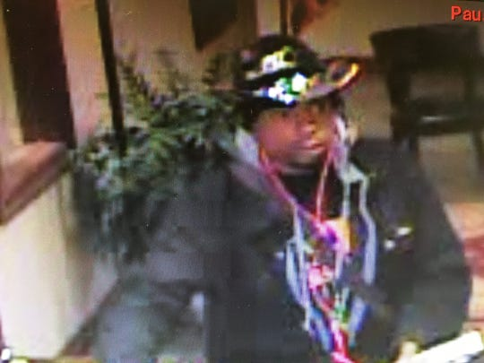 Surveillance footage captured a man police believe to be Keith Rogers during the robbery of the Aneca Federal Credit Union on Jan. 28.