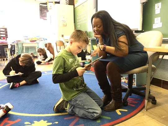 Aiesha Allen works with a student Feb. 11. For Black