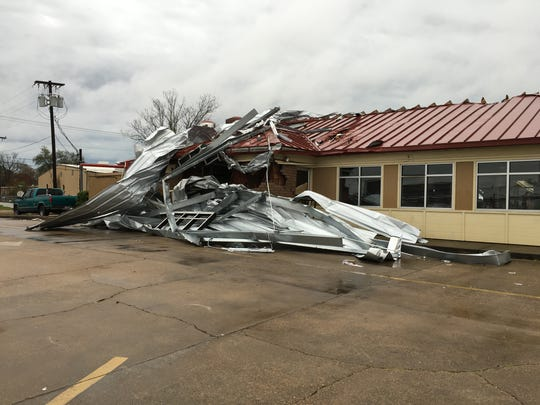 A storm Monday blew metal from Speedy Pete's Car Wash