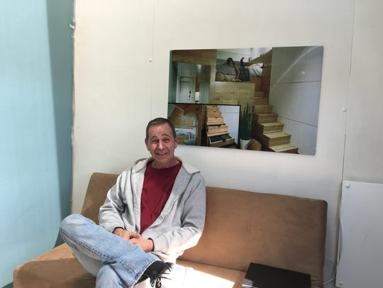Broker Jes Radle takes a break from painting the loft