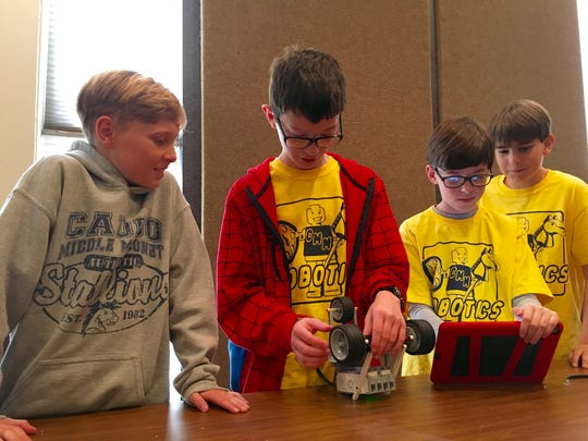 Caddo Middle Magnet School sixth-graders Major Wallace, Raiden Reed, Conner Nicholson and Sutton Oathout adjust their robot between challenges Wednesday at NSU-RC1, a robotics competition at Northwestern State University.