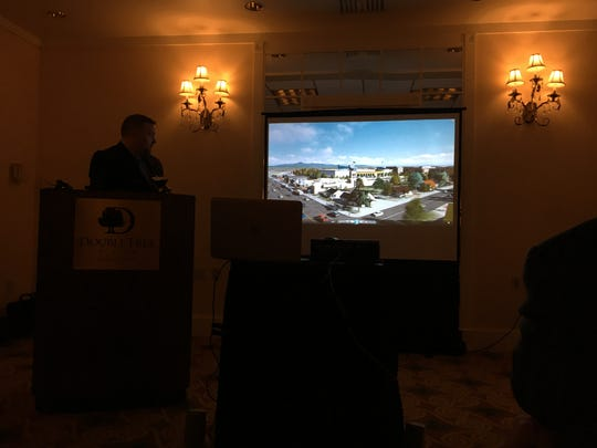 Burlington Architect Lee Dore shows a rendering of a proposed arena in South Burlington.