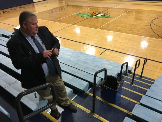 RHS principal Cody Patterson says Warrior fans are happy with the new hand railings in the school gym. He showed them to school board members Thursday.
