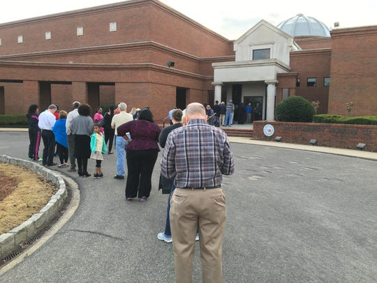 A crowd waits to vote in the Super Tuesday primary