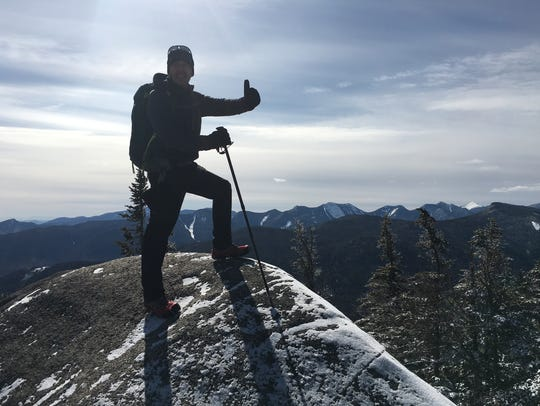 Dave Clark summits a mountain in the Adirondacks Saturday.