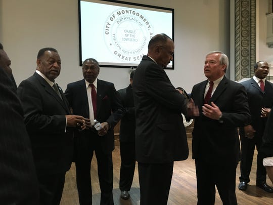 Business and civic leaders talk Wednesday at City Hall in Montgomery.