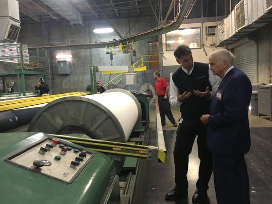Bill Marriott, chairman of the board of Marriott International, tours the Thomaston, Ga., plant of Standard Textile