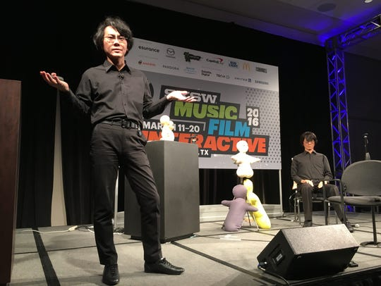 Hishori Ishiguro, left, explains the technology behind