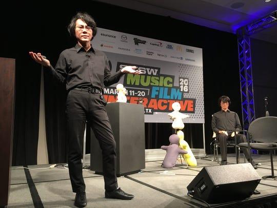 Hishori Ishiguro, left, explains the technology behind