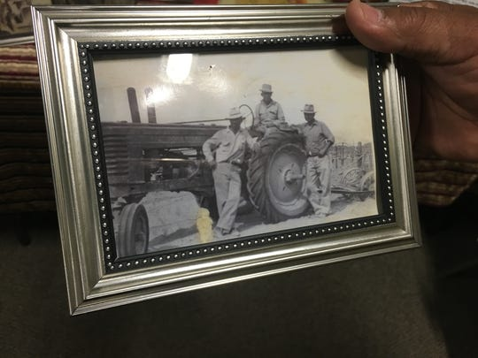 Raymond Arias shows off a picture of his grandfather. who came to the Coachella Valley from Mexico in the early 1900s. Arias was speaking about his family's history at the annual Coachella Valley Heritage Festival on March 19, 2016.