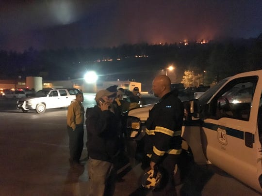 Ruidoso Fire Chief Harlan Vincent directs operations Monday night against the Moon Mountain fire from a command center in the Ruidoso High School parking lot.