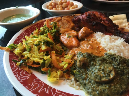 Chicken tikka masala, center, and other dishes from the $10.99 lunch buffet at India's Grill in Fort Myers.