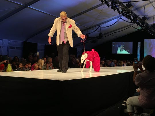 Dogs took to the catwalk Saturday night at the La Chien fashion show benefitting the Humane Society of the Desert at El Paseo Fashion Week.