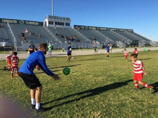Zach Stewart of UF works with youth soccer players.