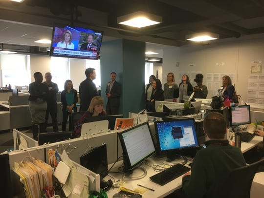 Detroit News Managing Editor Gary Miles takes a group