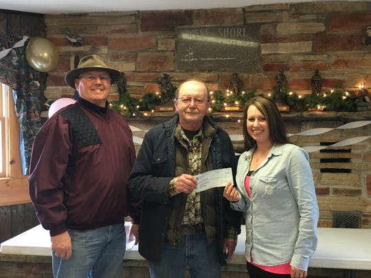 Westshore Sportsmen's Club recently held its annual Loree Kakuk memorial shoot with proceeds going to the American Cancer Society. This year, they also teamed up with the Tavern League. Pictured, Joseph Schepper (from left), Dave Barrett representing Westshore Sportsmen's Club and the Manitowoc County Tavern League, and Julie Kakuk, captain of their Relay for Life team.