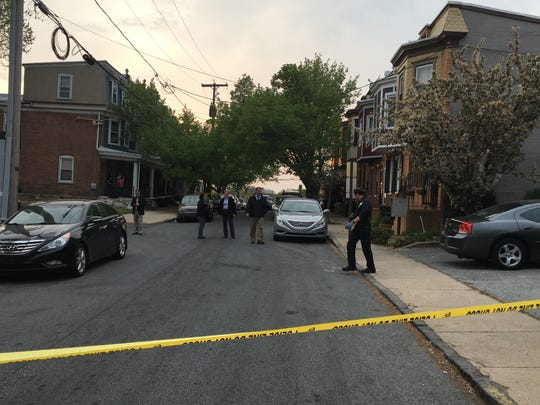 Police respond to a shooting in the area of West Third Street on April 21.
