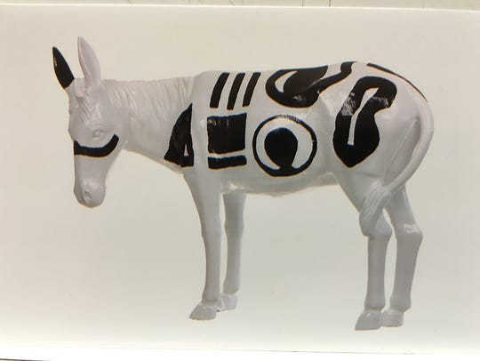 This is a photograph of a painted aluminum burro stolen