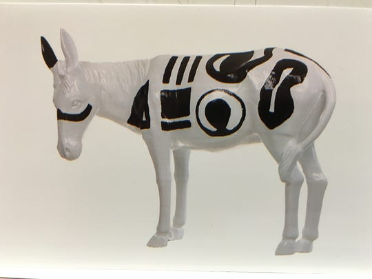 This is a photograph of a painted aluminum burro stolen from the porch of Patsy Sanchez's business in Carrizozo.