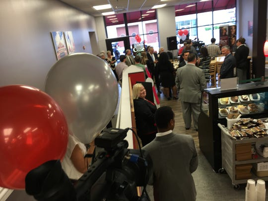 A crowd gathers Thursday for the grand opening of the Trojan Cafe in downtown Montgomery.