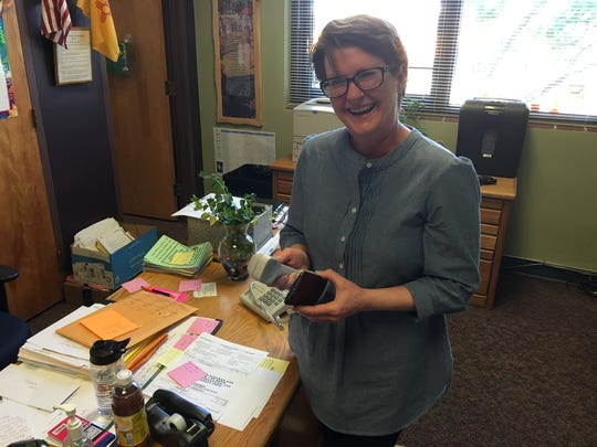 Nob Hill secretary Linda Whitley piped the commencement march from her iPhone into the school's public address system as RHS seniors trooped through.