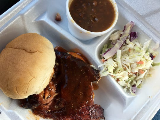 A rib sandwich with slaw and beans from Smokin R's BBQ in Bonita Springs featuring sauce made from owner's recipe.