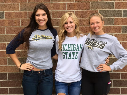 Hartland High School seniors wear the shirt of the college they will be attending next year on Tuesday during college signing day.