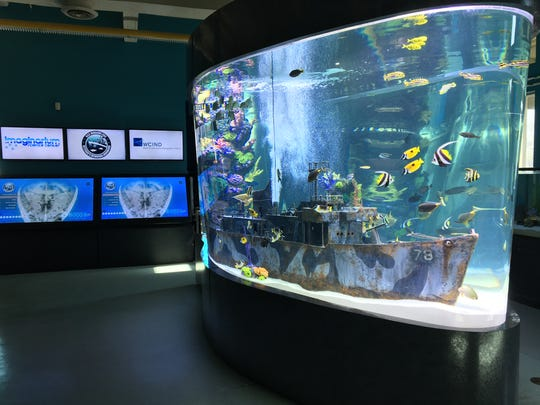 The Imaginarium's new aquarium combines science and history in one exhibit. The aquarium features both fish and the sunken warship USS Mohawk, now an artificial reef.