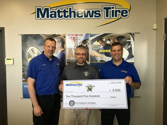 Patrick Smith, tire/service adviser at Matthews Tire Green Bay location, on the left, Steve Trinkner, Old Glory Honor Flight representative, in the middle and Trevor Rezner, president at Matthews Tire on the right.