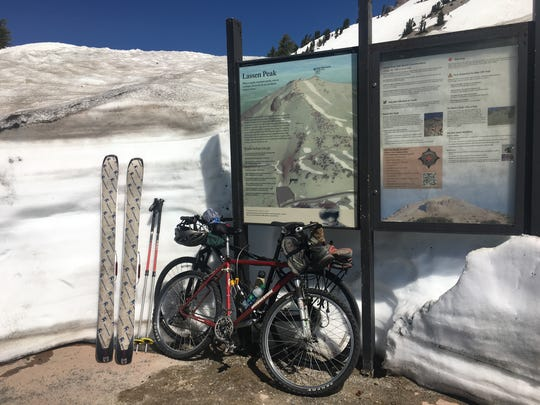 Whether you bike or drive there's still plenty of snow for skiing in higher elevations of Lassen Volcanic National Park.