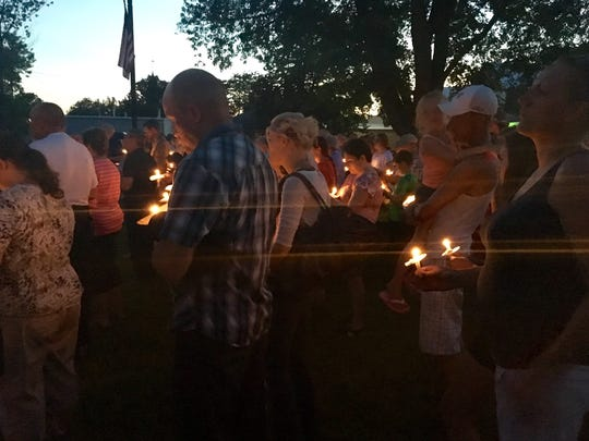 People gathered in Elgin Park on Sunday night for a candlelight vigil to honor 4-year-old Jayden Phillips, who died of an accidental gunshot wound.