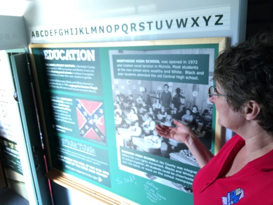 Beth Messner points out a display aboard the MLK Dream
