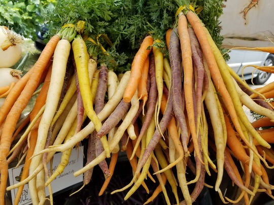 Multicolored carrots from Paper Crane Farm can add pizzazz to your meals.