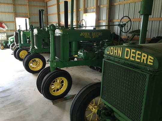 Vintage John Deere tractors such as those in this lineup
