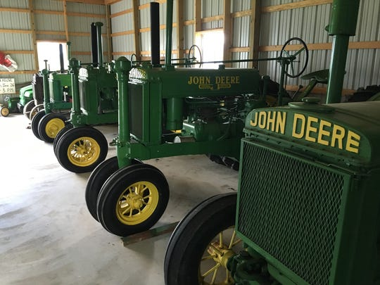 Vintage John Deere tractors such as those in this lineup will be the featured model at the first antique tractor show at the Franklin County Fair.