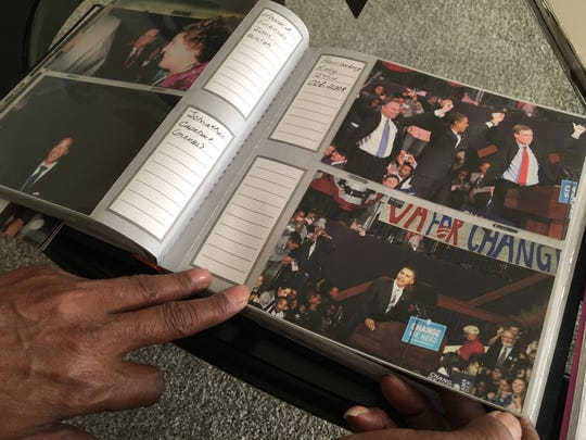 Barbara Lee flips through her album of photos from the Democratic National Convention in 2008.
