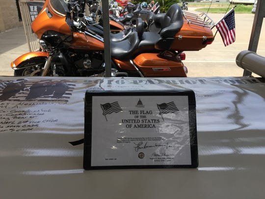 Each rider signs a book that travels with the flag.