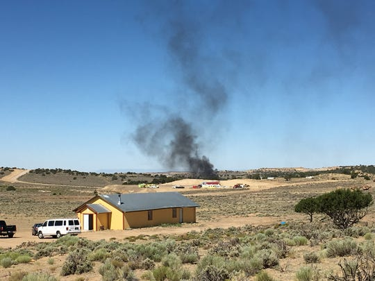 Smoke billows on Tuesday from a fire at a WPX Energy oil production site near Nageezi.
