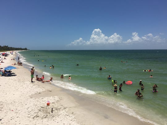Bathers enjoy a portion of the Collier County coastlne near the Naples Pier on July 6.