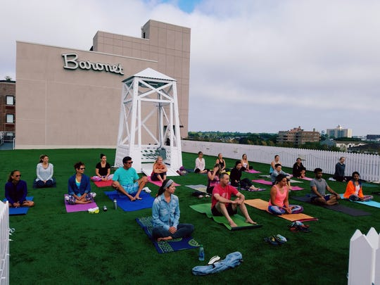 Rooftop yoga on the Baronet.