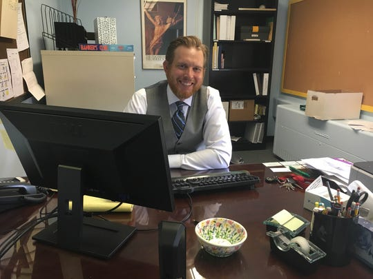 New principal Rob Frey sits in his relocated office
