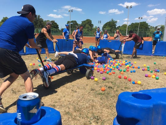 "Teams compete in ""Roller Dash,"" a Hungry Hungry Hippo-like game July 23, 2016 during the Labatt Undomesticated Games on Belle Isle."