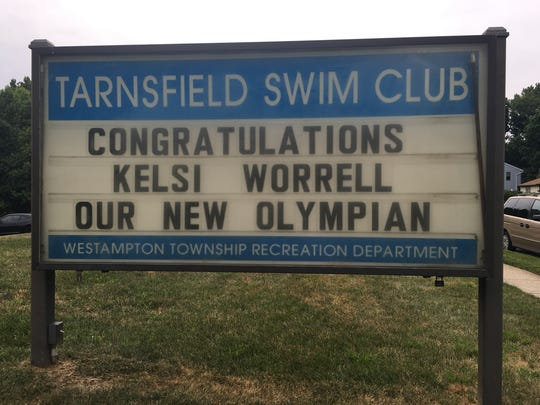 A sign outside Kelsi Worrell's hometown Tarnsfield Swim Club in Westampton, N.J., offers congratulations on her making the U.S. Olympic team