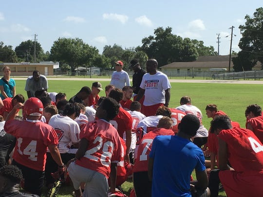 North Fort Myers High football coach Earnest Graham address his team following the first practice of fall camp on Monday.