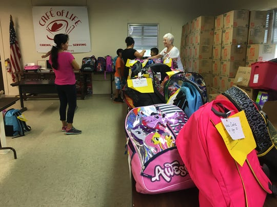 Café of Life distributed free backpacks to school children at its location in Bonita Springs. The backpacks were filled with school supplies.